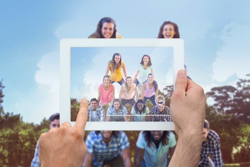 Samengesteld beeld van de tabletpc van de handholding stock foto's