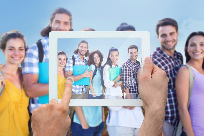 Samengesteld beeld van de tabletpc van de handholding royalty-vrije stock foto's