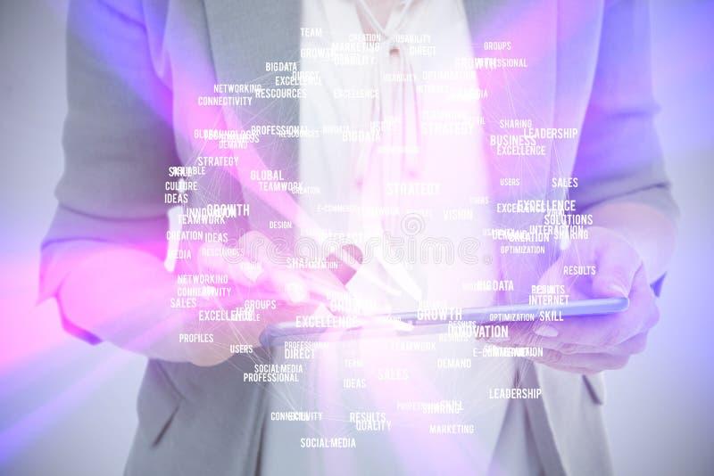 Samengesteld beeld van dichte omhooggaand van vrouw die tablet gebruiken royalty-vrije stock foto