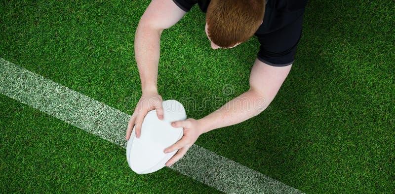 Samengesteld beeld van een rugbyspeler die een poging noteren royalty-vrije stock afbeeldingen