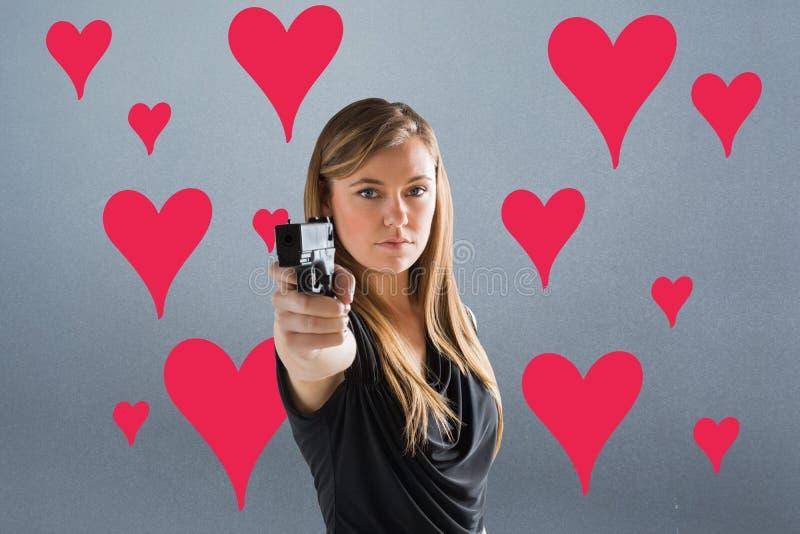Samengesteld beeld van femme die fatale kanon richten op camera stock afbeelding