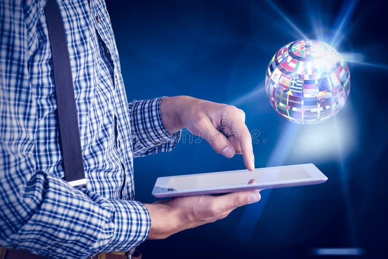 Samengesteld beeld van geeky zakenman die zijn tabletpc met behulp van royalty-vrije stock foto's
