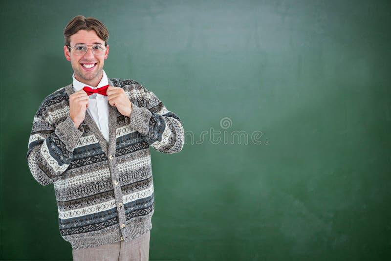 Samengesteld beeld van gelukkige geeky hipster met woljasje stock afbeelding