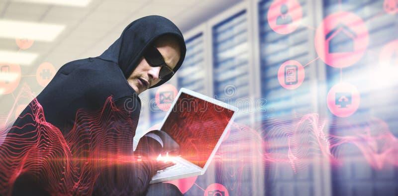 Samengesteld beeld van hakker die laptop met behulp van om identiteit te stelen royalty-vrije stock foto's