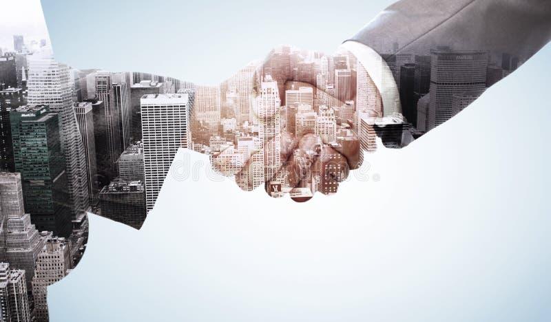 Samengesteld beeld van handdruk tussen twee bedrijfsmensen stock foto's