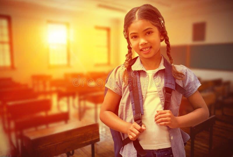 Samengesteld beeld van het leuke leerling glimlachen bij camera stock foto