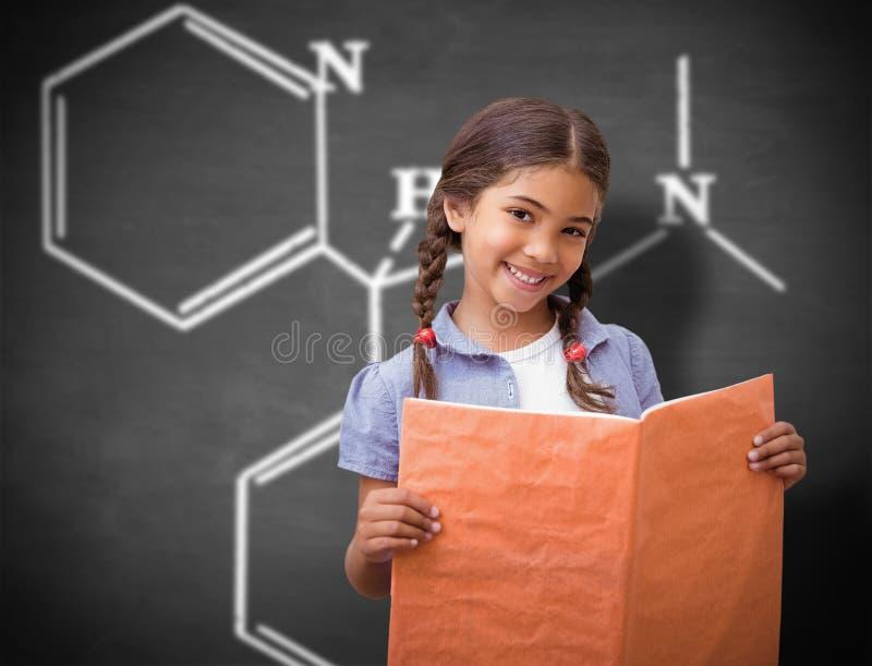 Samengesteld beeld van het leuke leerling glimlachen bij camera tijdens klassenpresentatie royalty-vrije stock afbeelding