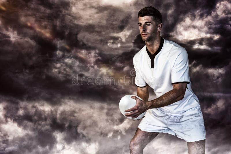 Samengesteld beeld van het rugbybal van de spelerholding stock afbeelding