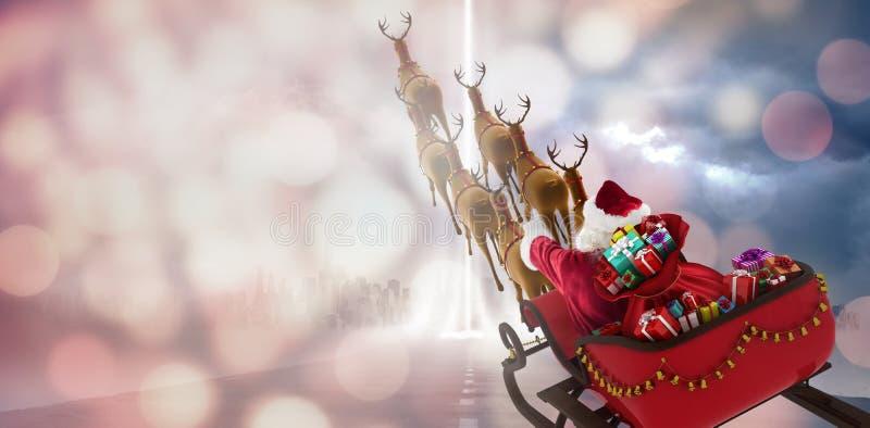 Samengesteld beeld van hoge hoekmening van de Kerstman die op slee met giftdoos berijden royalty-vrije stock foto