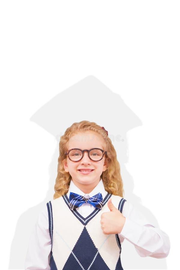 Samengesteld beeld van leerling met omhoog duimen stock foto