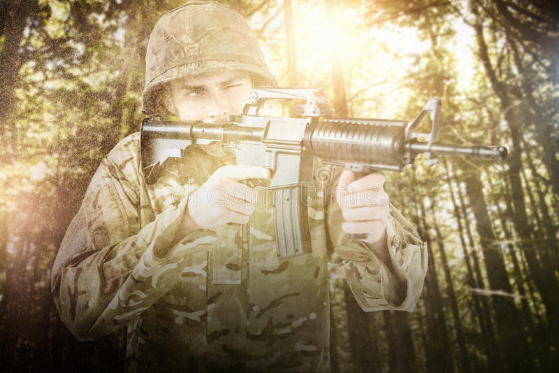 Samengesteld beeld van militair het streven met geweer stock foto's