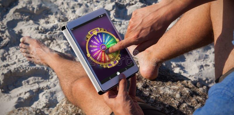 Samengesteld beeld van multi gekleurd fortuin van wiel op mobiele vertoning stock afbeelding