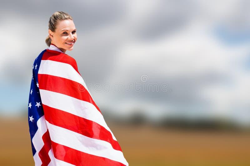 Samengesteld beeld van portret van het gelukkige Amerikaanse sportvrouw stellen royalty-vrije stock fotografie
