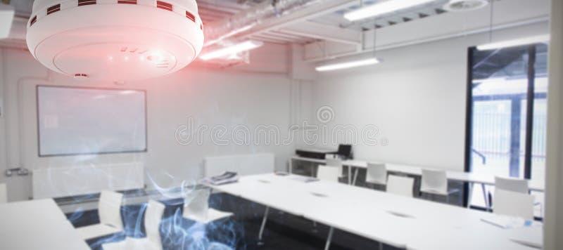 Samengesteld beeld van rook en branddetector royalty-vrije stock foto's