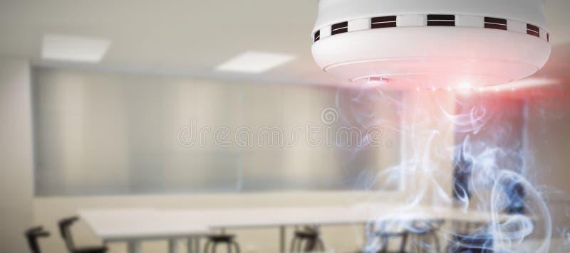 Samengesteld beeld van rook en branddetector royalty-vrije stock afbeeldingen