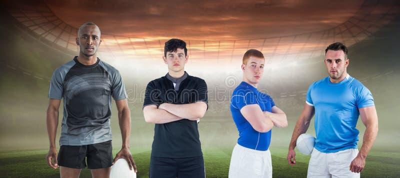 Samengesteld beeld van taaie rugbyspelers stock afbeelding