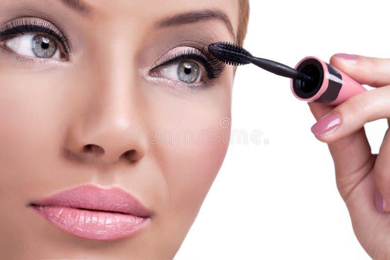 Samenstelling, die mascara toepassen stock foto's