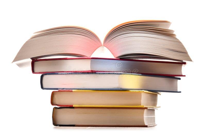 Samenstelling met boeken die op wit wordt geïsoleerde royalty-vrije stock foto's