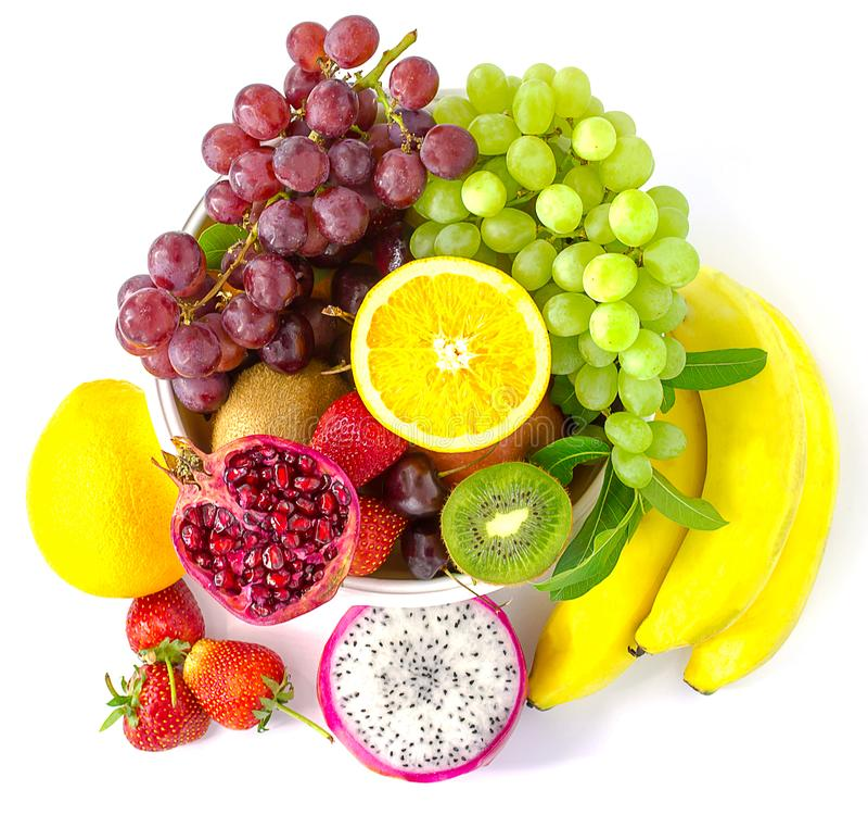 Samenstelling met geassorteerde die vruchten op witte achtergrond wordt geïsoleerd met stock foto's