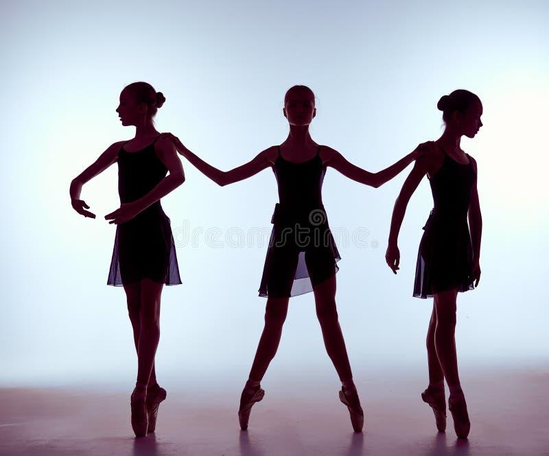 Samenstelling van silhouetten van jong ballet drie royalty-vrije stock fotografie