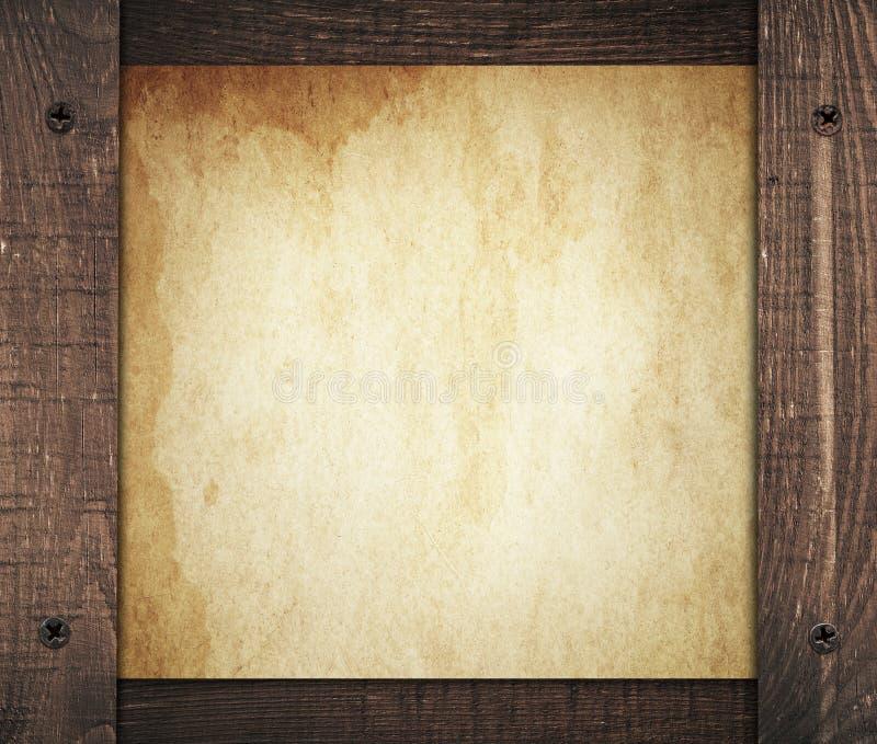 Samenstelling van uitstekend vuil document met oude houten stock afbeelding