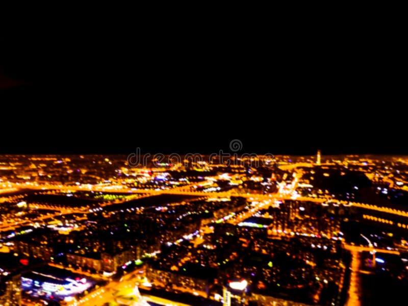Samenvatting Vage achtergrond Luchtnachtmening van een grote stad Cityscape panorama bokeh bij nacht Onscherpe Luchtmening van wo stock afbeeldingen
