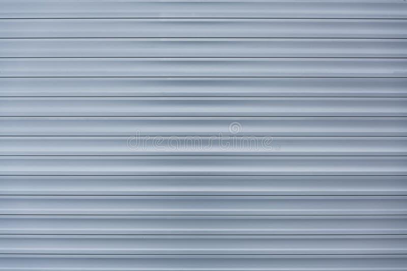 samenvatting van streeppatroon van de deuren van het rolblind of de rollende achtergrond van staaldeuren stock afbeeldingen