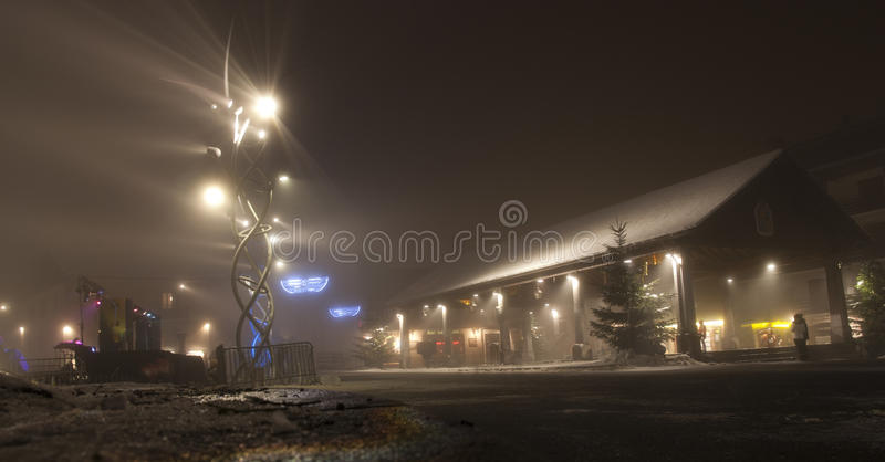 Sameons, France at night in Winter. Misty night with lights and flare stock photography