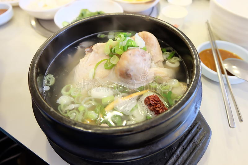 Samgyetang Ginseng Chicken Soup. Samgyetang 삼계탕 is a chicken soup made with a small, whole chicken and ginseng. It's an iconic summer royalty free stock photo