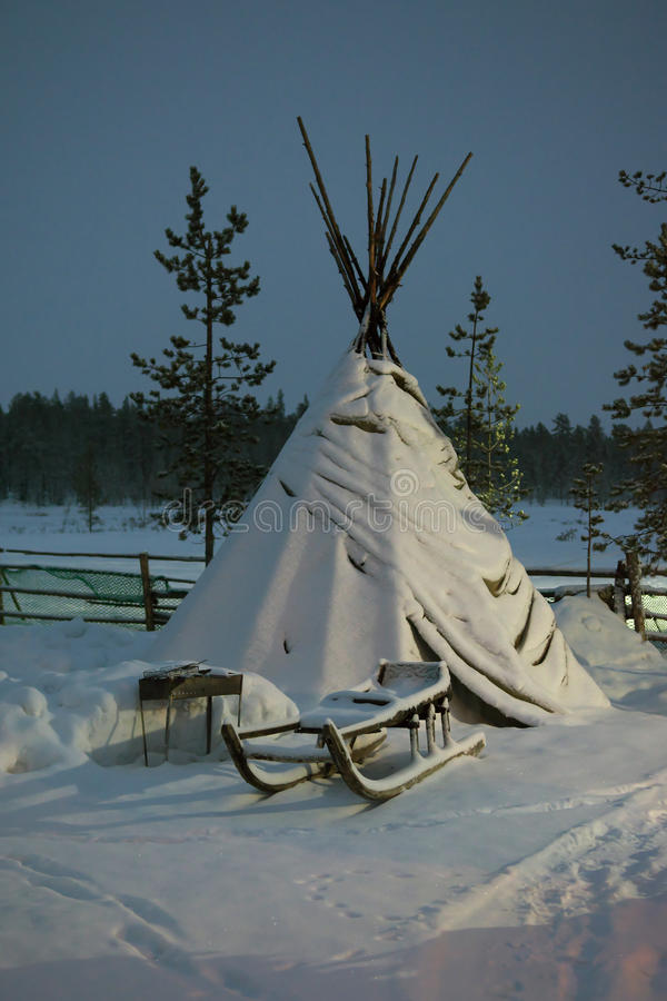 Sami tent and standing next to the sled during the polar night.  stock image