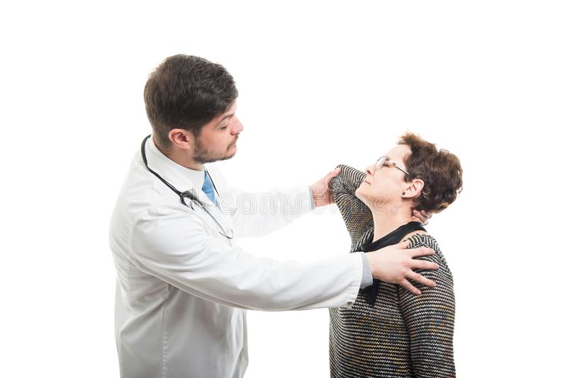 Samiec doktorskiego rozciągania żeński starszy pacjent fotografia stock