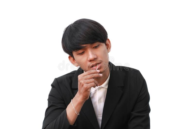 Samiec jego czyści zęby z wykałaczką na białym tle obrazy stock