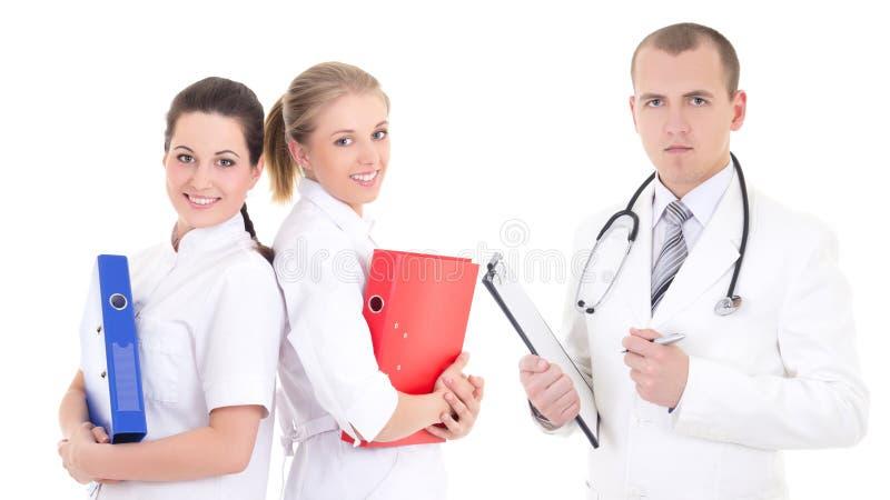 Samiec lekarka i dwa młodej pielęgniarki odizolowywających na bielu fotografia stock