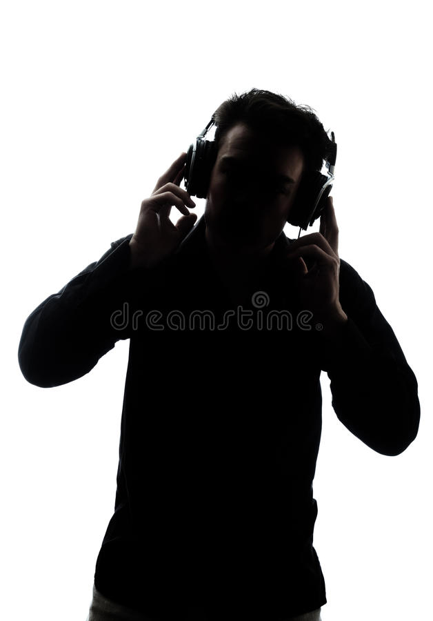 Samiec słucha hełmofony w sylwetce fotografia stock