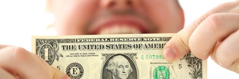 Samiec wr?cza mieniu jeden dolara ameryka?skiego banknot robi niekt?re punktowi o biznesowym sukcesie obrazy stock