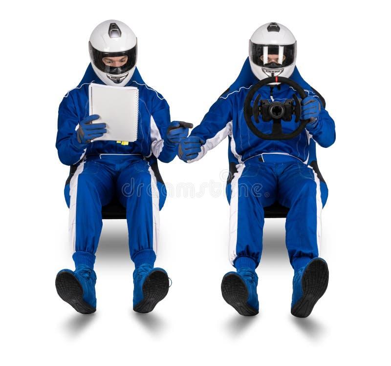 Samla den drev- och Co-piloten passageraren som läser pacenoteboksvävandet på att springa ytterlighet för begrepp för motorsport  fotografering för bildbyråer