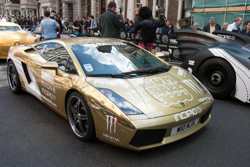 samlar guldgumballlambourghinien 2010 london royaltyfri foto