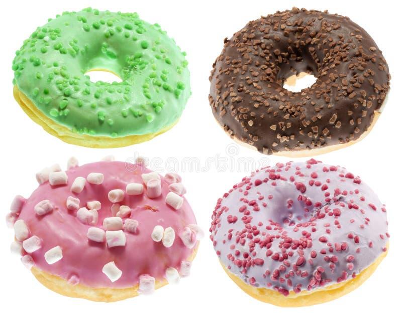 Samling av donuts som isoleras på den vita bakgrunden arkivbild