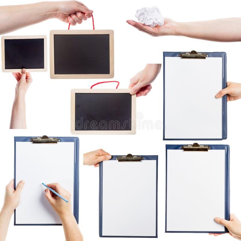 Samling av händer som rymmer skrivplattor, svart tavla och papper royaltyfria foton