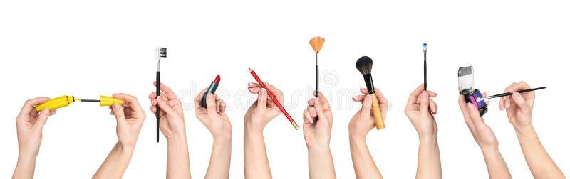 Samling av hållande hjälpmedel för händer för makeup arkivbild