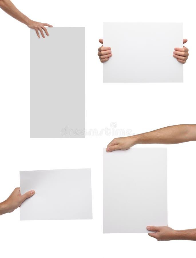 Samling av handen som rymmer tomt papper isolerat royaltyfria foton