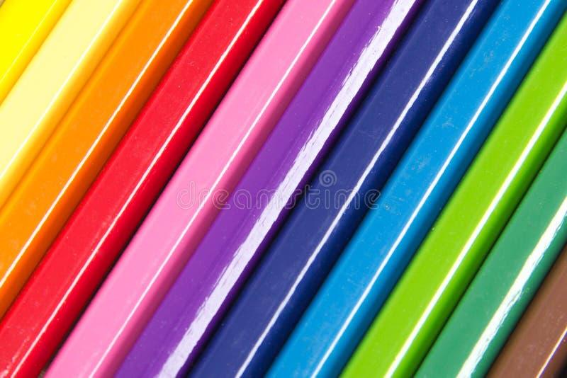Samling av kulöra blyertspennor som bildar en bakgrund royaltyfri foto