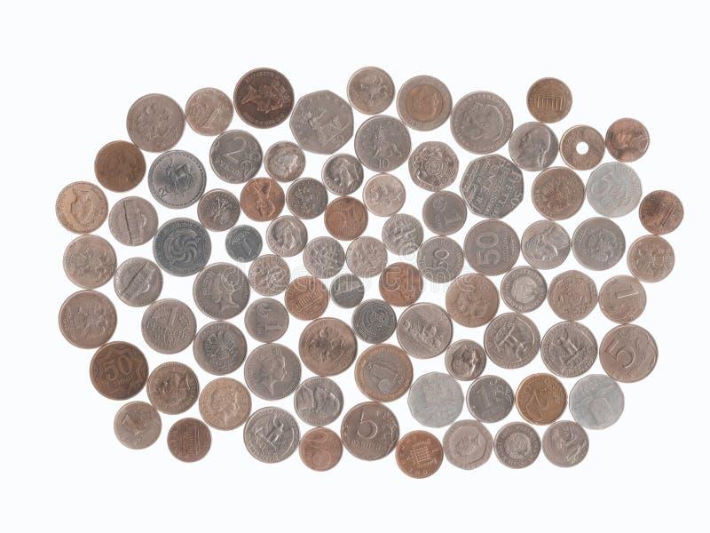 Samling av mynt av olika länder som kommas med från turist- turer arkivfoton
