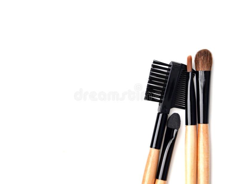 Samling av träborstesminket kosmetiskt hjälpmedel arkivfoton