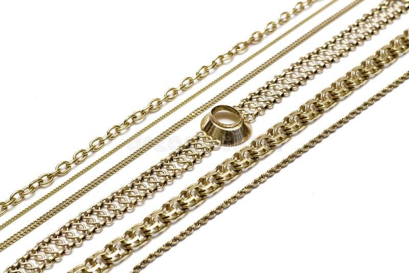 sammankoppliner guld royaltyfri bild