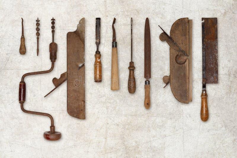 Sammansättning av gamla hjälpmedel för trä royaltyfri foto
