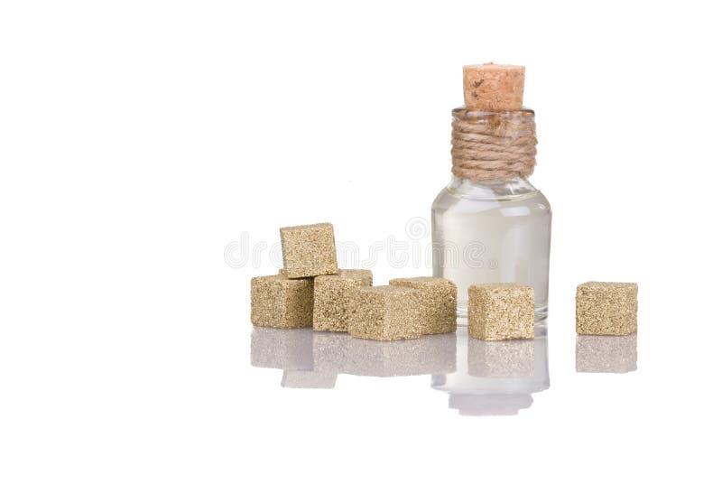 Sammansättning av guld- sockerkuber royaltyfri bild