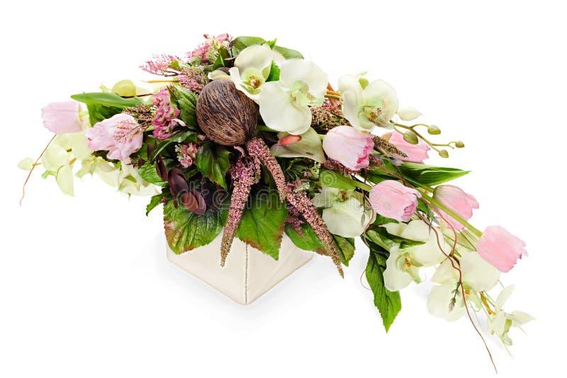 Sammansättning från orchids, tulpan, kokosnöt, rocks royaltyfri bild