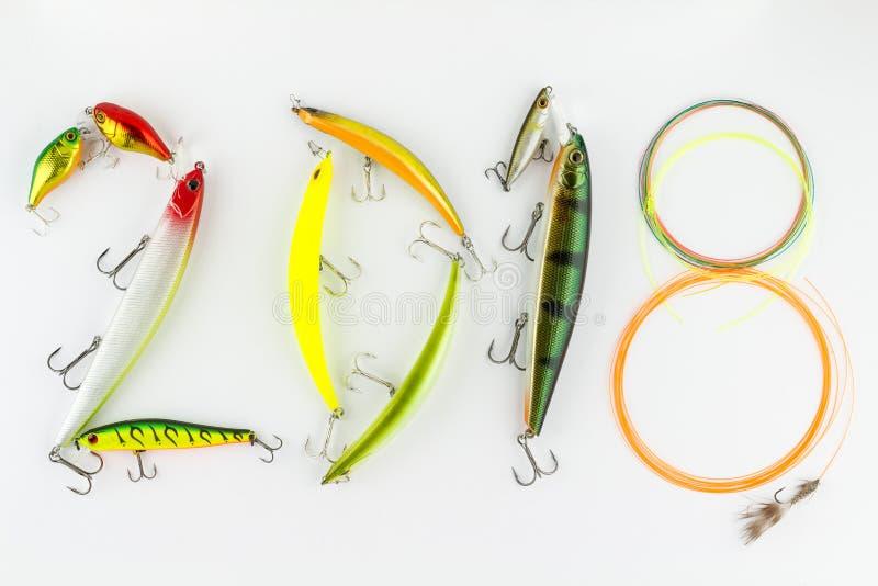 Sammansättningar för lyckligt nytt år 2018 med fiske lockar och rever royaltyfri bild