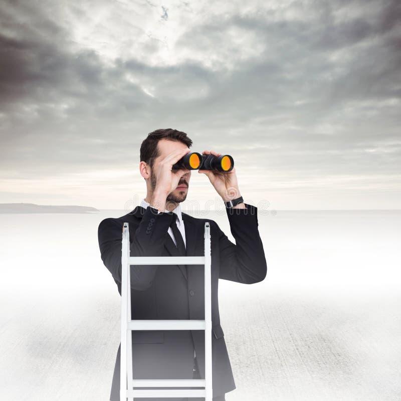 Sammansatt bild av affärsmannen som ser på en stege arkivfoton